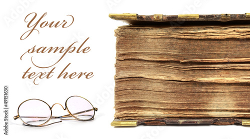 17th century book with vintage glasses