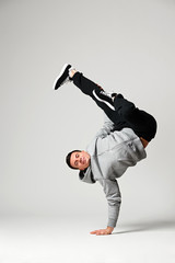 cool dancer posing over grey background