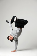 hip-hop dancer over grey background