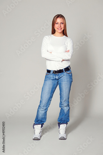 smiley young woman with folded hands