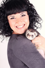 Curly brunette posing with the ferret