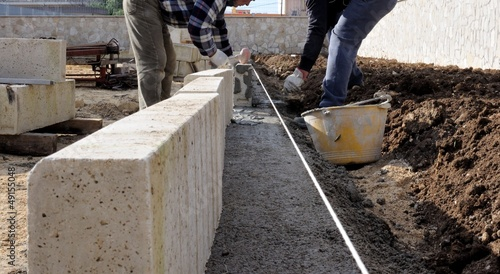 Construction site - Workers laying concrete curbs
