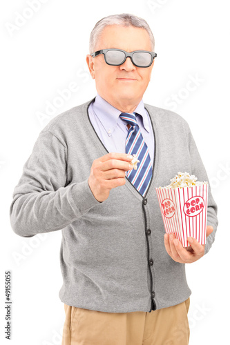 Mature gentleman eating popcorn