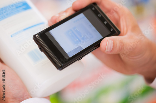 Shopper scanning barcode on product