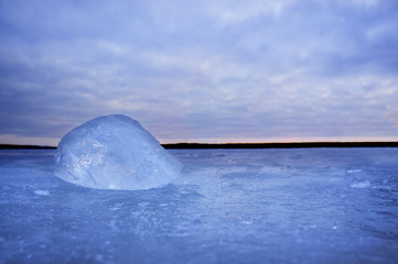 lump of ice on frozen lake