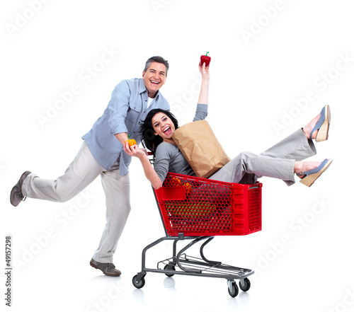 Happy couple with a grocery shopping cart.