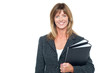 Cheerful secretary holding business files