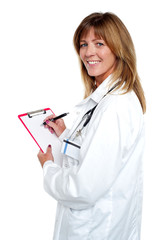 Beautiful smiling physician writing prescription