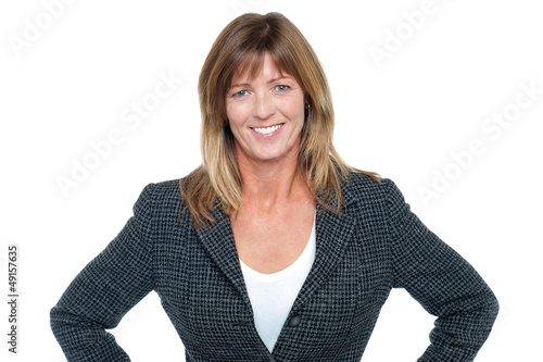 Business executive with hands on her waist