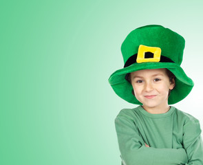 Child with a big hat of Saint Patrick«s Day