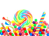 Colorful assortment of candy forming a border over white
