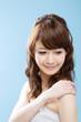 Beautiful asian woman on blue background