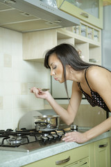 Attractive girl in lingerie home cook in the kitchen