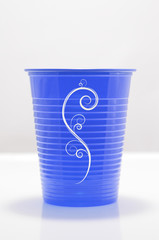 blue color plastic cup with draw in white