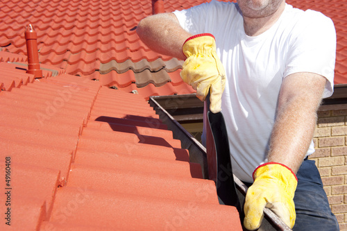 Seasonal Gutter cleaning red roof