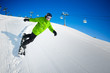 Snowboarder on pise in high mountains
