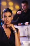 Elegant woman sitting at dinner table