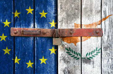 EU and Cyprus flag on the background of old locked doors