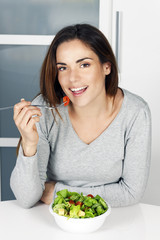 girl eating healthy food at home