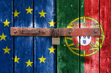 EU and Portugal flag on the background of old locked doors