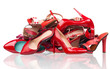 Pile of various red female shoes over white
