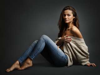 Young beautiful woman sitting on floor