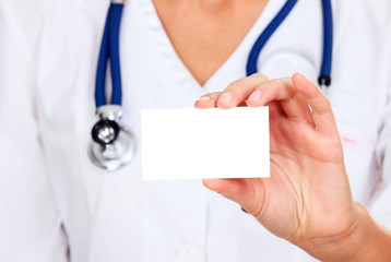 Female doctor shows empty white card