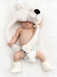 Lovely sleeping baby with big bear