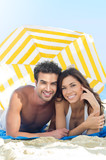 Smiling Couple Enjoying At Beach