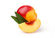 With a slice of peach and leaves. isolated on a white background