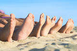 Feet relax at beach