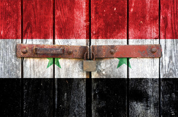 Syria flag on the background of old locked doors
