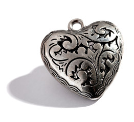 Ornate silver heart shaped locket