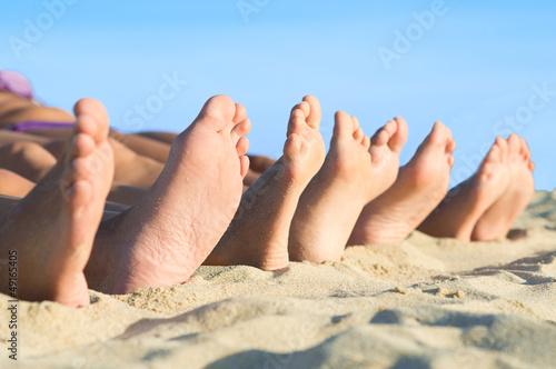 Feet relax at beach