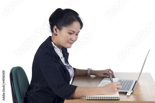 Portrait of confident business woman sitting at the table and wo