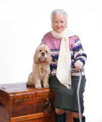 Old woman sitting on a box with a dog