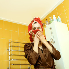 funny ordinary girl in the bathroom wiping his head