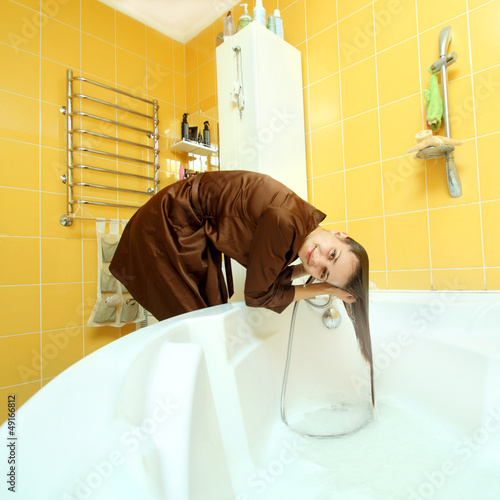 ordinary girl in the bathroom washing her head