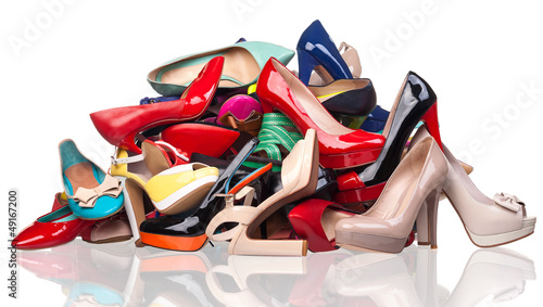 canvas print picture Pile of various female shoes over white