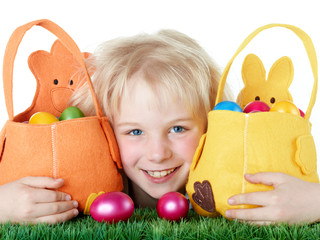 Cute blonde child is happy to found her Easter baskets