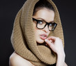 Attractive woman with a hood and glasses