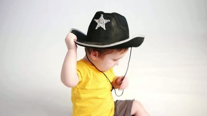 little boy with officers hat