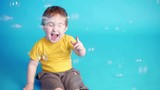 cheerful kid playing with bubbles laughing
