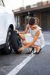 flat tire woman