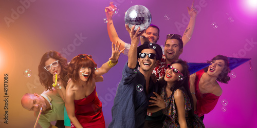 young people partying with disco ball