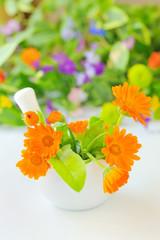 Calendula flowers and mortar