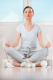 Yoga meditation at home. Relaxation concept with unrecognizable poster