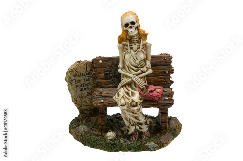 Skeleton of a woman on the bench