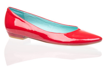 Red patent leather pump over white background