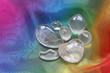 clear healing crystals on rainbow chiffon